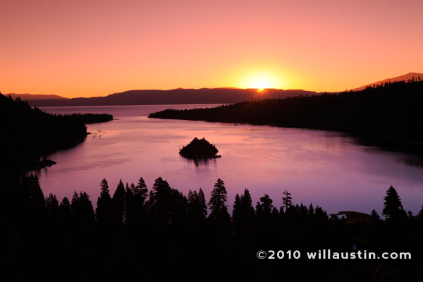 Glowing surise over Emerald Bay at Lake Tahoe.
