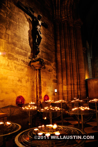 Candles and Christ on Cross Statue, Notre Dame Cathedral in Paris