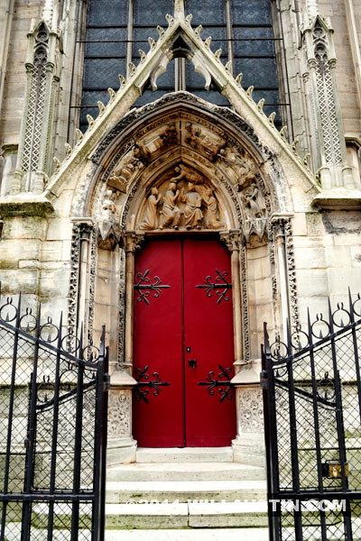 Gothic Architecture, Red Side Door at the Notre Dame Cathedral in Paris