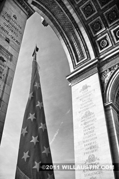 The American Flag at the Arc de Triomphe in Paris, France