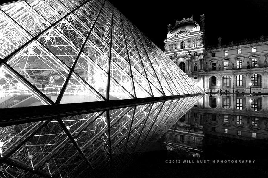 Paris Louvre Museum pyramid night black and white photo by Will Austin
