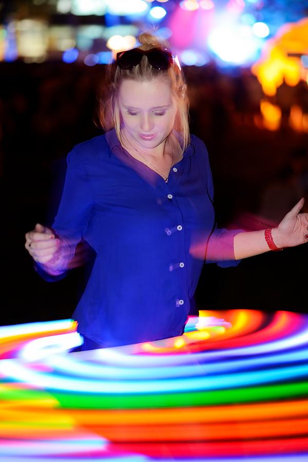 Woman with glowing hula hoop at Bumbershoot 2013 in Seattle