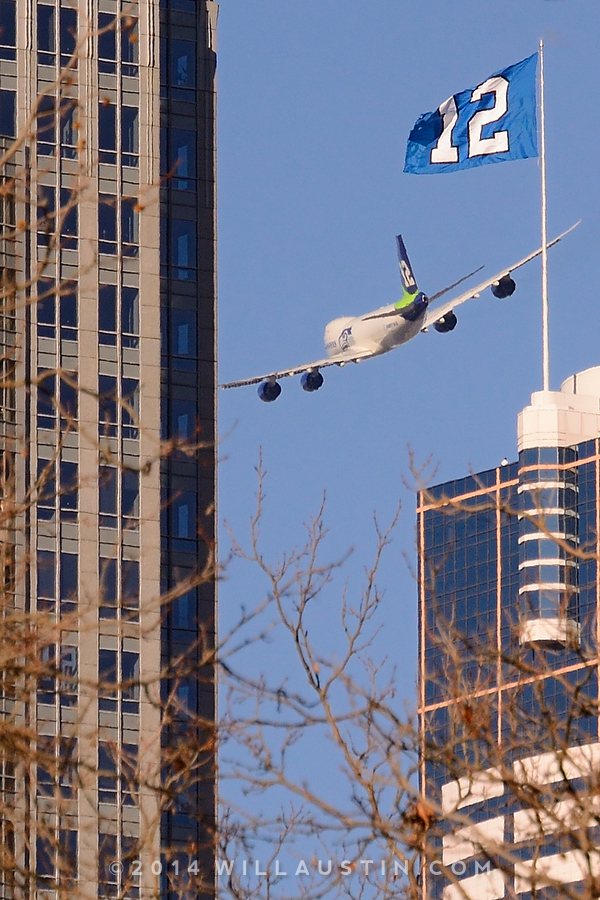 Boeing Seahawks 747 buzzes the city of Seattle during the Super Bowl parade.