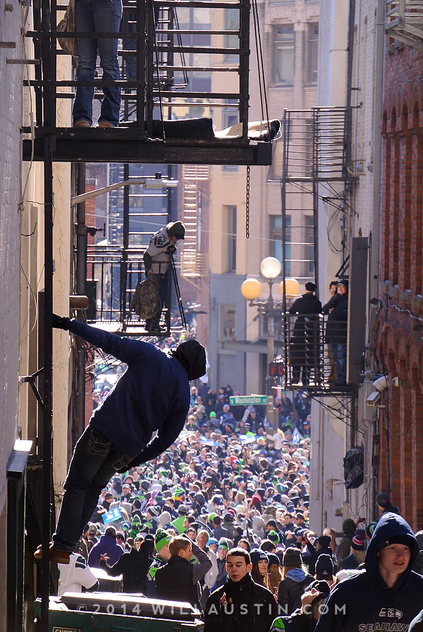 Seahawks fans amass and some climb fire escapes.