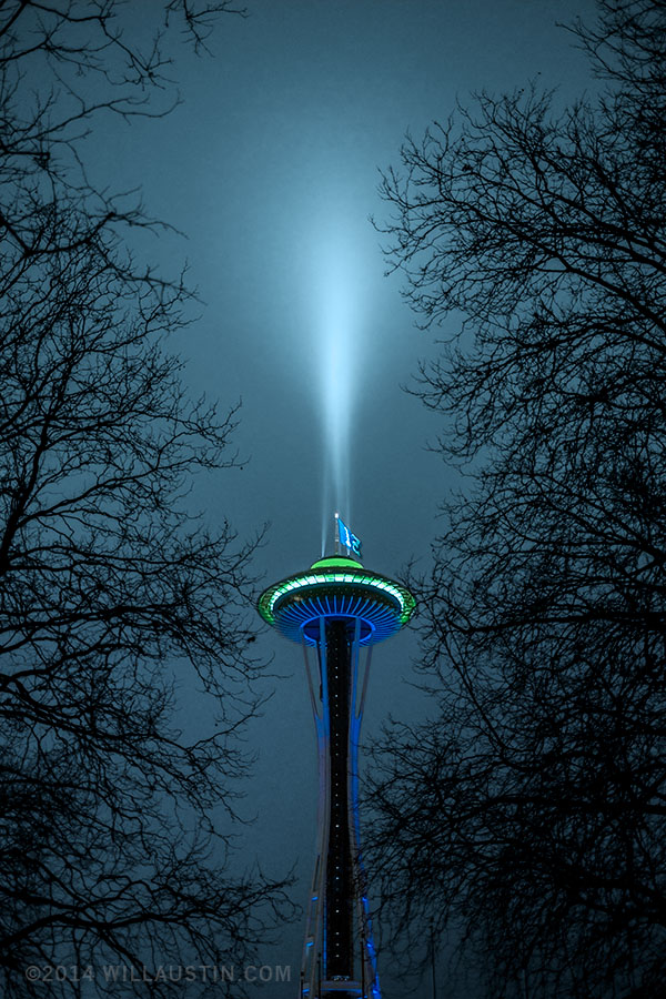Photo of the Seattle Space Needle at night lit with the colors of the Seattle Seahawks football team