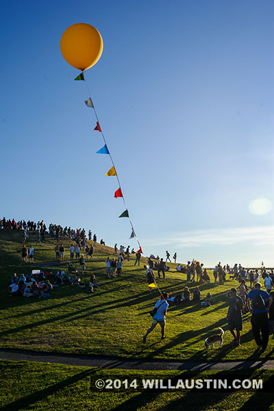 Crowd and baloon at Gasworks park after the 2014 Fremont Solstice Parade in Seattle