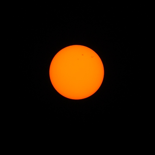 Sun photographed through forest fire smoke showing sun spots by Will Austin Photography